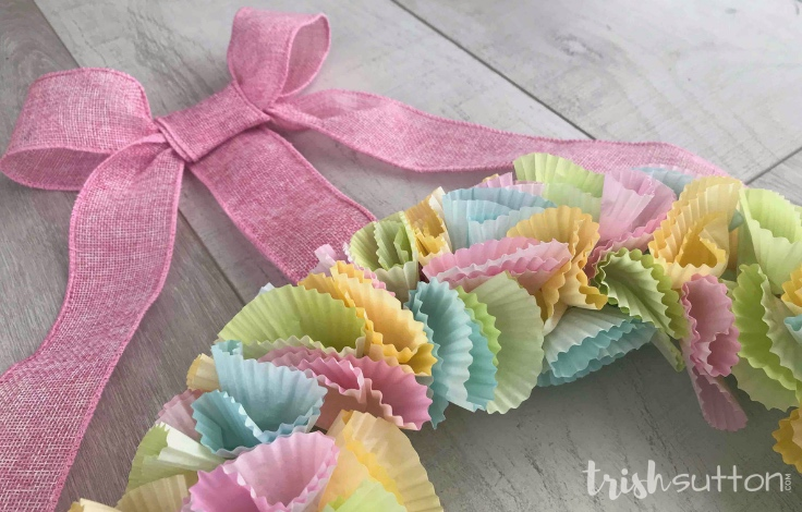 Create a Cupcake Liner Wreath with fun prints and seasonal shades. Colorful seasonal decor is made easy with this simple tutorial. TrishSutton.com