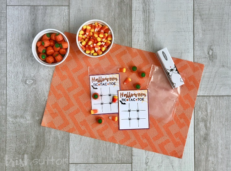 supplies to create Halloween party favors including free printable, candies, party bags & stapler