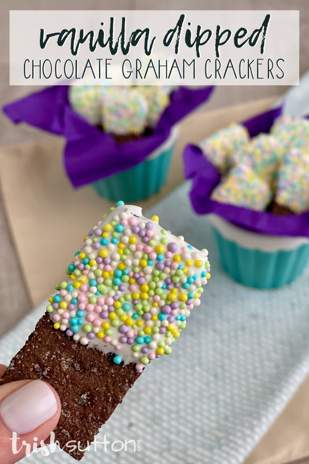 chocolate cracker with sprinkles and crackers covered in sprinkles on a purple napkin inside a blue bowl in the background