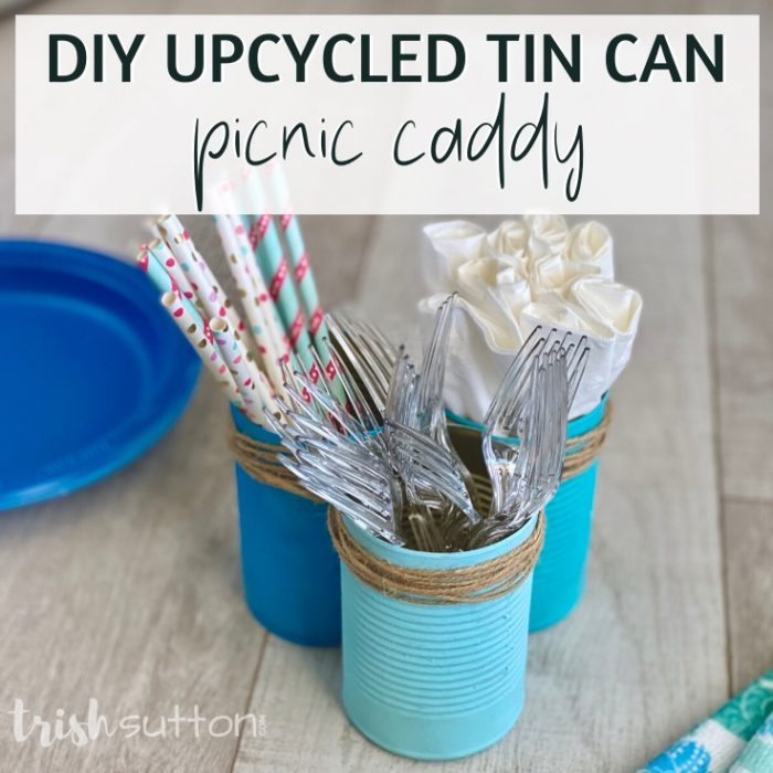 DIY caddy with forks, straws & napkins on a wood background.