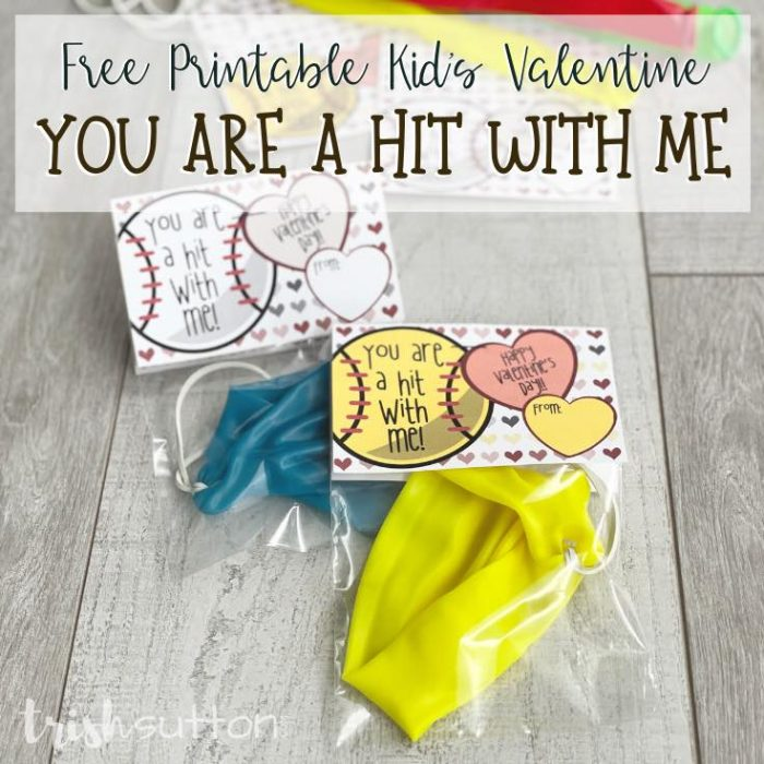 """Share a sports themed Kids Valentine with these """"You Are a Hit With Me"""" free printable notes paired with a baseball or softball treat."""